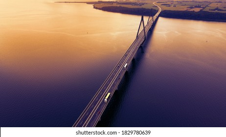 Bridge spanning over a bay with traffic passing in the evening light. Aerial view.