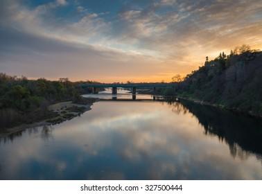 Bridge Spans River at Sunset in Sacramento