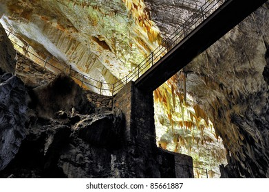 Bridge, stalactites and stalagmites in an underground cavern - Postojna cave