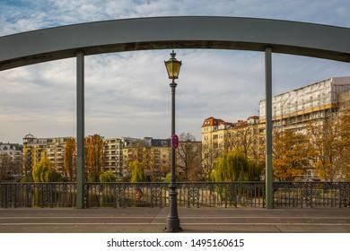 Bridge with street lamp in Berlin in autumn