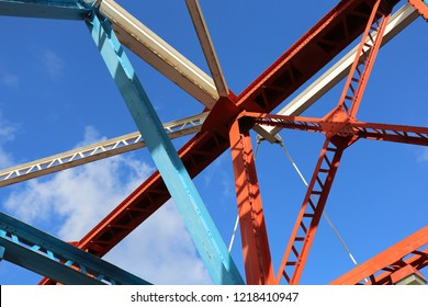 bridge structure painted bright colours blue sky abstract pattern old structure steel frame