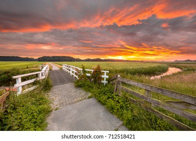 Bridge at sunrise over lowland river Grootdiep near Oosterwolde, Friesland, Netherlands