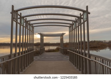 Bridge at sunset on the boardwalk over Purgatory Creek