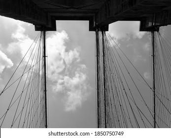 Bridge suspension cables over a cloudy sky