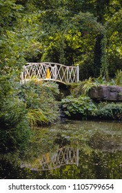 Bridge in Swiss Garden in Old Warden Park located in Biggleswade on the River Ivel in Bedfordshire, England