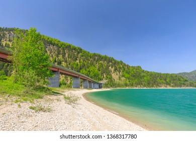 Bridge at Sylvensteinsee in summer