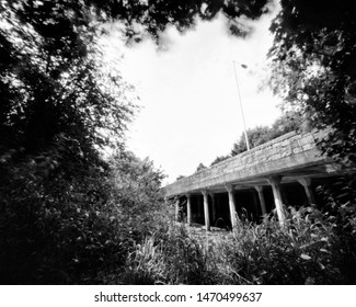 bridge and trees in the spring, this black and white camera obscura photo is NOT sharp due to camera characteristic. Taken on analogue photographic large  format negative film with a pinhole camera.