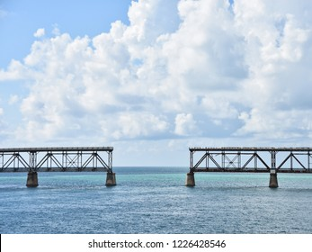 bridge in two halves, not connected, against beautiful sunny and cloudy skies, tropical blue water in Florida Keys