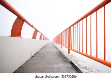 Bridge vanishing point in fog