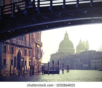 bridge in Venice Italy called Ponte della Accademia and the Church of Madonna della Salute with vintage effect