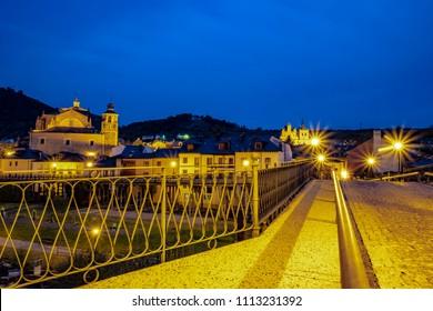 The bridge  with view of the collegiate church of Santa María de Cluniaes in Villafranca del Bierzo.