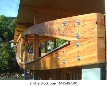 Bridge with a wooden structure made of glued laminated timber held together by steel screws.