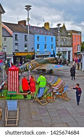 Bridgend, Bridgend County Borough / Wales UK - 6/15/2019: 'Wartime Bridgend'. Annual event recreating sights & sounds of WWII. A reproduction Hawker Hurricane  in Dunraven Place. Punch & Judy stall.
