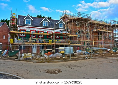 Bridgend, County Borough of Bridgend / Wales UK: 12/1/2019: Building construction site of Persimmon Homes in Bridgend, S.Wales. Partially completed timber-framed new homes surrounded by scaffolding.
