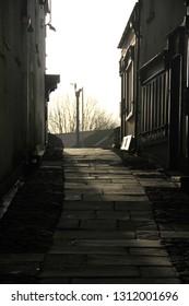 bridgend uk 8th February 2019 dimly lit alleyway with flagstone walkway leading uphill