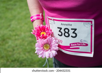 BRIDGEND, UK - JUNE 1: Closeup of competitor holding flowers at Race for Life Event on June 1, 2014 at Newbridge Fields in Bridgend, UK.