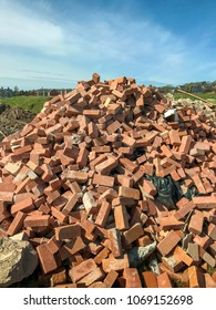 Bridgend, Wales- April 2018: Pile of house bricks dumped in a field