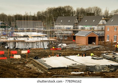 Bridgend, Wales - December 2017: Foundations for a new house on a building site with completed houses in the background