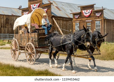 Bridgeport California - August 11, 2018 -Living in the Past Lane Annual Festival at Bodie State Park. Bodie is a Ghost Town in Mono County California. Horse drawn wagon in old town.