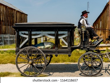 Bridgeport California - August 11, 2018 -Living in the Past Lane Annual Festival at Bodie State Park. Horses pulling wagon with undertaker in old west scene hauling a body
