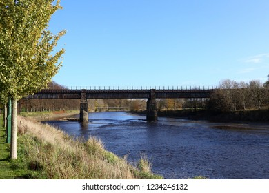 Bridges over the River Ribble, Preston. Disused rail bridge in the centre with the old tram road bridge in the distance crossing from Avenham and Miller Parks on the left to South Ribble on the right.