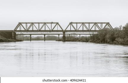 Bridges over river Ugra. Kaluga region, Russia. Black-and-white in light tinting
