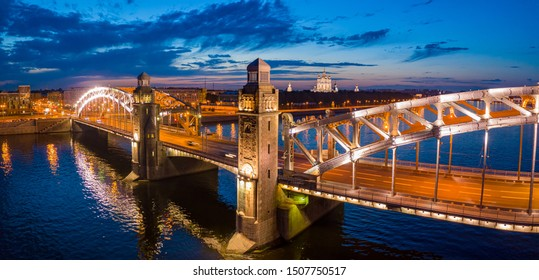 Bridges of St. Petersburg in Illumination. Russia. Peter the Great Bridge in St. Petersburg. Bolsheokhtinsky bridge at night. Night St. Petersburg. Cities of Russia. Vacations in Russia.