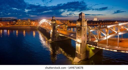 Bridges Of St. Petersburg. Russia. A panoramic view of night Petersburg. Bolsheokhtinsky bridge. Peter The Great Bridge. Rivers Of St. Petersburg. Neva River. Travel to Russia.