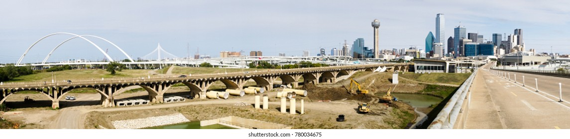 Bridges traverse the river and lead commuters into Dallas Texas