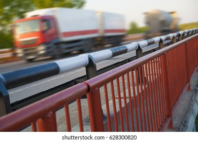 Bridges and two 2 high-speed driving truck. blurred photo. truck speeding through a bridge at sunset,motion blur. transportation background. industrial image photo.