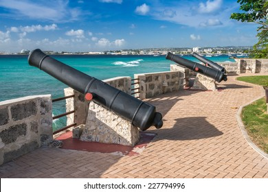 BRIDGETOWN, BARBADOS - DECEMBER 13, 2013 : Cannons pointing out to sea over Carlisle Bay, at Charles Fort, Needham's Point, near Bridgetown in Barbados.