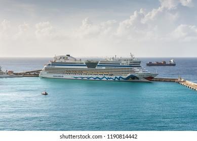 Bridgetown, Barbados - December 18, 2016: AIDA Diva cruise ship operated by the German cruise line AIDA Cruises moored in port of Bridgetown, Barbados island, Caribbean paradise.
