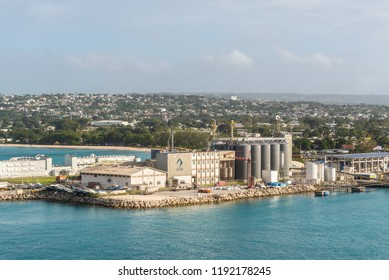 Bridgetown, Barbados - December 18, 2016: Grain Silos and port infrastructure at Freight Port of Bridgetown, Barbados island, Caribbean.