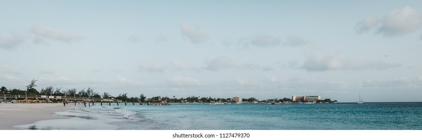 Bridgetown, Barbados - June 26, 2018: Panoramic view of Carlisle Bay's turquoise water and beach in Bridgetown. It is a popular tourist destination in the heart of a UNESCO World Heritage Site.