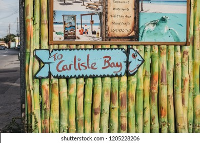 Bridgetown, Barbados - June 26, 2018: Arrow sign to Carlisle Bay in Bridgetown, Barbados. Carlisle Bay is a popular tourist destination located within UNESCO World Heritage Site.