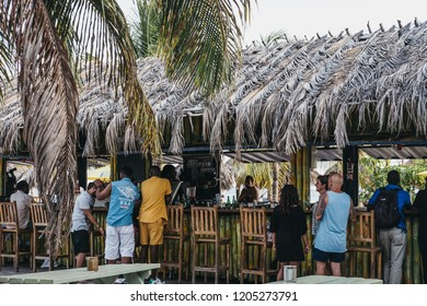 Bridgetown, Barbados - June 26, 2018: People at Pirate's Cove beach bar in Carlisle Bay in Bridgetown, Barbados. Carlisle Bay is a popular tourist destination located within UNESCO World Heritage Site