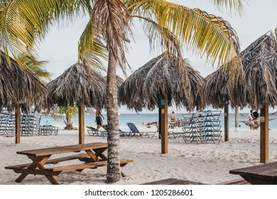 Bridgetown, Barbados - June 26, 2018: Tables and umbrellas in Carlisle Bay beach, Bridgetown, Barbados. Carlisle Bay is a popular tourist destination located within UNESCO World Heritage Site.