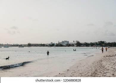 Bridgetown, Barbados - June 26, 2018: View of Carlisle Bay in Bridgetown, Barbados, at dusk. Carlisle Bay is a popular tourist destination and is UNESCO World Heritage Site.