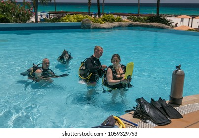 Bridgetown, Barbados, March 19, 2018: People are taking initial SCUBA lessons in a hotel pool.