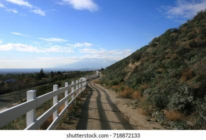 Bridle path running along a hill side in a suburban neighborhood, California