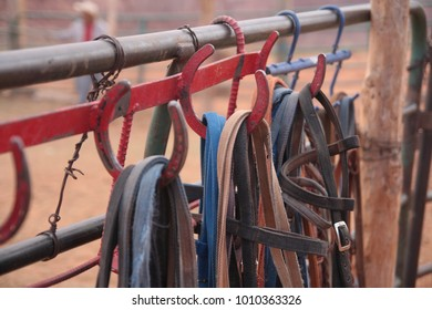 Bridles hanging from tack hooks on a metal horse fence. Close up detail. Monument Valley Navajo Tribal Park, Wyoming.