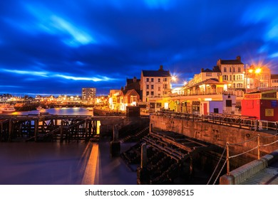 BRIDLINGTON, ENGLAND - FEBRUARY 24: View of Bridlington shops and seafront at night. In Bridlington, England. On 24th February 2018.
