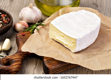 Brie Cheese on wooden background