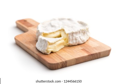 The brie cheese. Tasty camembert isolated on white background.