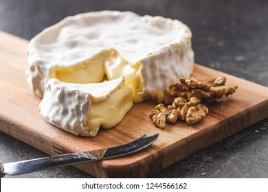 The brie cheese. Tasty camembert and walnuts.