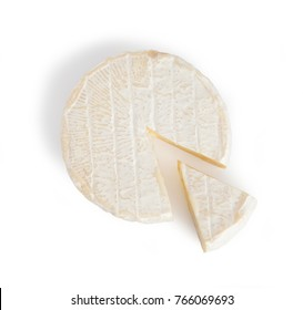 Brie type of cheesewhit cheese sliced. Camembert cheese. Fresh Brie cheese. French cheese. Isolated on a white background.