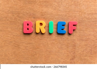 brief colorful word on the wooden background