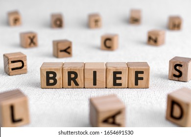 Brief - words from wooden blocks with letters, of short duration instruct or inform brief concept, white background - Shutterstock ID 1654691530