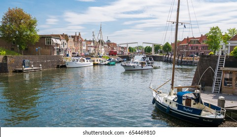 BRIELLE, NETHERLANDS - MAY 17, 2017: Harbour with boats and bridge in old town of Brielle, Voorne-Putten, South Holland, Netherlands