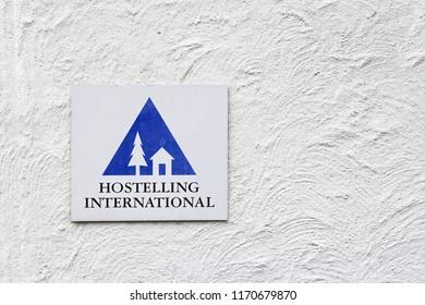Brienz, Switzerland – February 18, 2018. - Hostelling International lsign on white wall